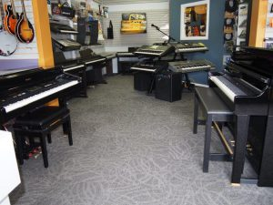 The pianos showing off the new carpet. (or is it the other way around?)